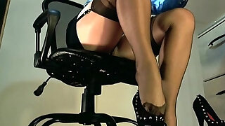 Underdesk tease showing stockings over nylons - duration 7:00