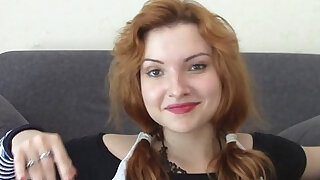 Horny redhead masturbating on the couch - duration 6:00