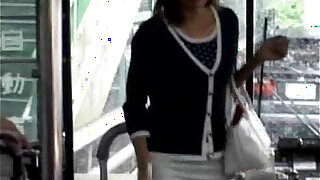 A young Asian teen girl enters a public bus and sits down from - duration 0:56