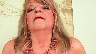 Grandmother with large breasts pushes huge black dildo inside - duration 6:00